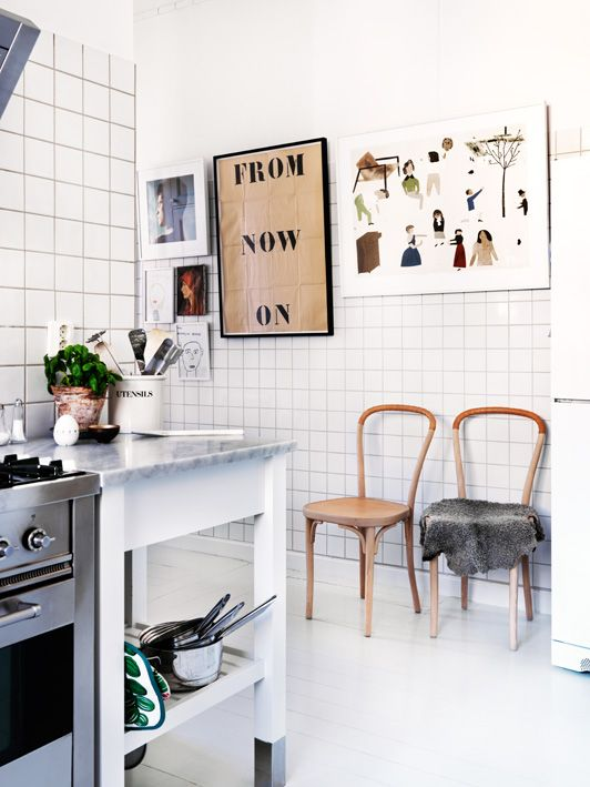White kitchen tiles and leather chairs - via Coco Lapine Design