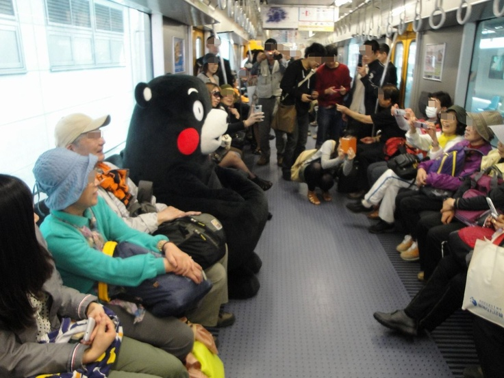 Kumamon, the mascot charactor of Kumamoto Pref. Japan, is moving by local train.