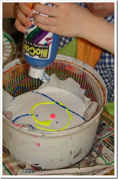salad spinner for t-shirts, paper, ribbons. LOVE. need to get myself another salad spinner