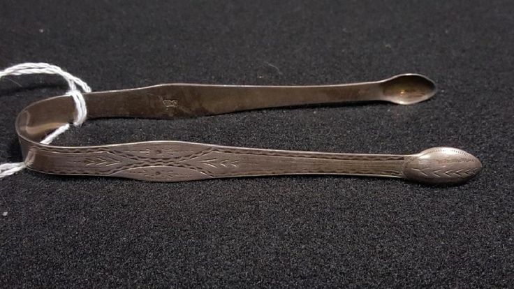 """Hester Bateman Sugar Tongs"""" long. Asking $275. Open to offers. With """"HB"""" script mark, (lion), (King's head left). C. 1784. Engraved exterior design- with monogram """"M / W & M'. Bateman 1708-1794."""