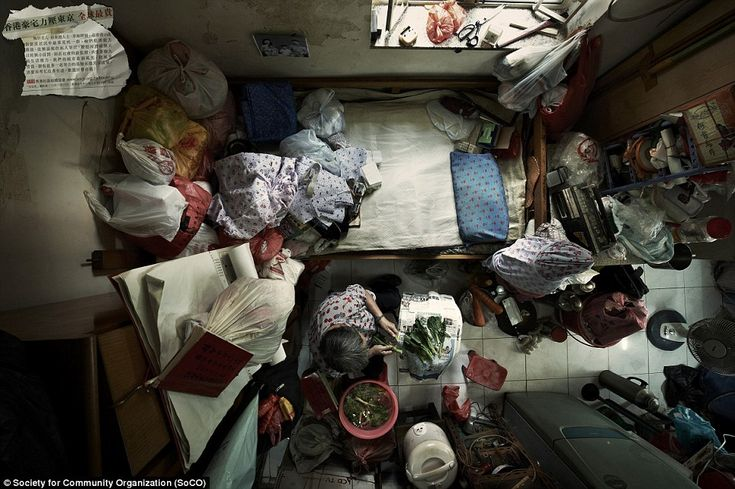 Hong Kong's human battery hens: Claustrophobic images show how slum families squeeze their lives into the tiniest apartments | Mail Online