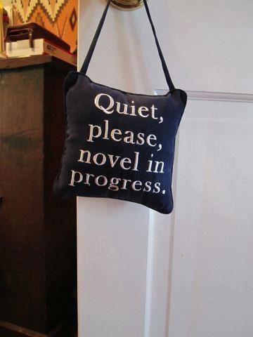 """""""Quiet please, novel in progress"""" door hanger."""
