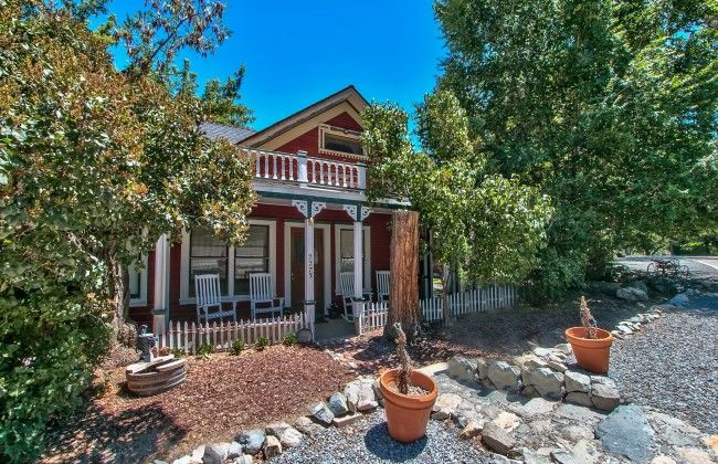 This charming, ca. 1858 cottage comes complete with an adorable guest house and a barn that was formerly used as a saddlery shop.