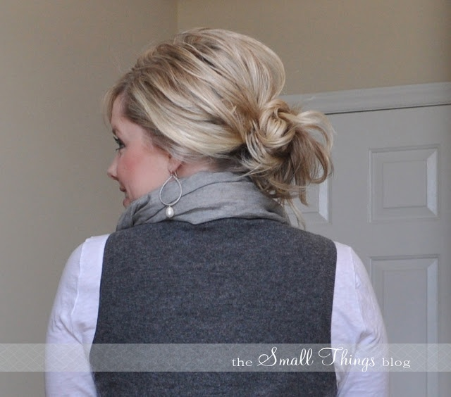 Messy bun:  Grab loosely, pull back from the ears & up so you don't loose crown volume.  Wrap another elastic once around the rest of the hair to make a messy bun & scruffle with your fingers.