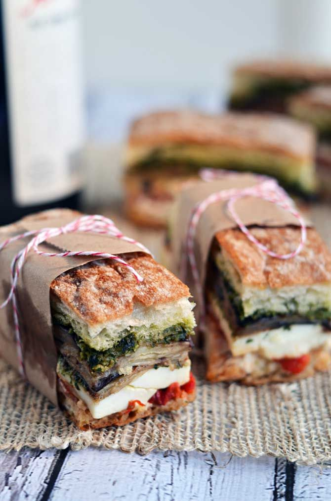 Eggplant, prosciutto, and pesto pressed sandwiches are packable and picnic-friendly.