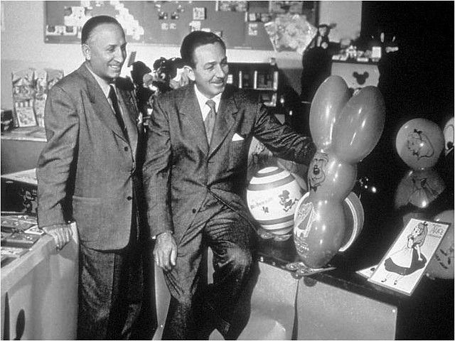 """Check it out, they had a secondary character printed on a balloon for """"Alice in Wonderland"""". Though you never see a costume the March Hare is quite memorable.  Voiced by Jerry Colonna.  In the picture sits Walt Disney and his brother Roy Disney."""