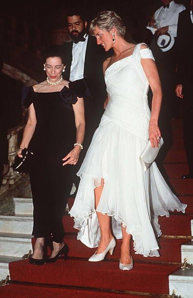 Princess Diana In Rio De Janeiro, Brazil Attends A Charity Gala Ballet Performance At The Municipal Theatre. Wearing A White Chiffon Dress Designed By Fashion Gina Fratini For Hartnell