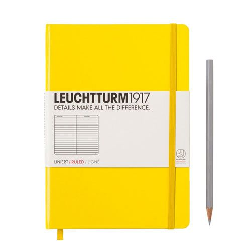 Notebook A5 Lined Lemon  £11.95 VAT  Simply, the best notebook around in a great fashionable colour Lemon: Hardcover A5 notebook from Leuchtturm1917, with ruled paper. Includes 249 pages, thread bound to open flat, blank table of contents, 8 perforated and detachable sheets, expandable pocket, page marker and elastic enclosure band, stickers for labelling and archiving, ink proof and acid free paper. Details make all the difference! Free matching pen loop! Size: 21 x 15 cm