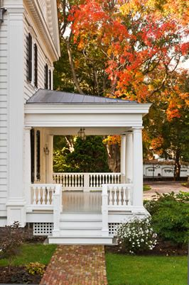 Such a great side porch and entrance. Though I'm afraid mine would never be this pristine....there would be hockey bags, dog toys, boots, and far too much other clutter. Still, a woman can dream...