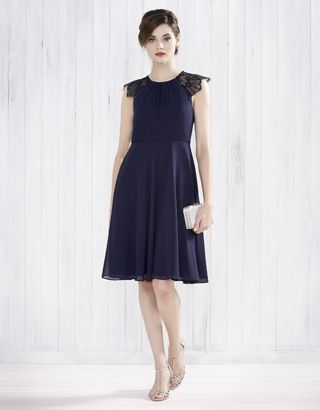 Our elegant Bluebell dress is crafted with a softly-gathered bodice with a round-cut neckline, and adorned with lace cap sleeves with scalloped edges. The insert binding on the waist accentuates the narrowest part of the silhouette, while the gently-flared skirt creates a feminine finish. Features a keyhole button detail, and a concealed zip fastening on the reverse. Fabric swatches for colour matching included.