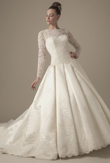 Brides.com: Dennis Basso - 2014. Satin and lace pleated A-line wedding dress with long sleeves and lace illusion neckline, Dennis Basso