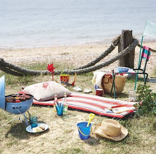 A day at the beach...take folding chairs, mats and cushions to the beach for seaside style, keeping things simple with enamel plates and melamine glasses.