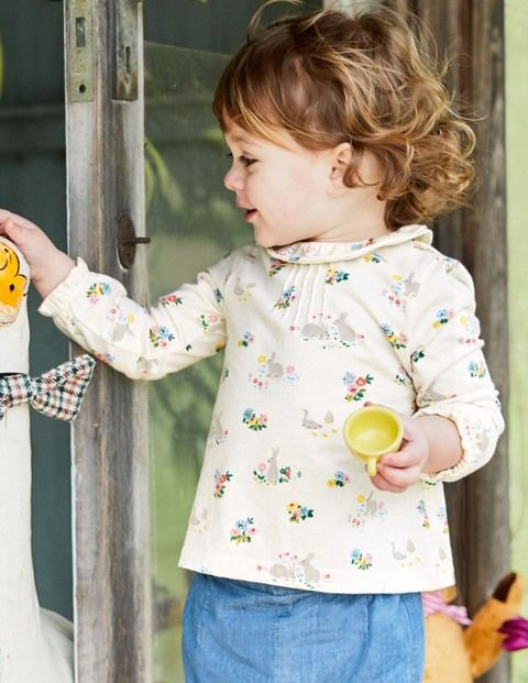 We've added a ruffled collar and sleeves to this pretty printed tee, so everyone will coo over your little one more than ever. It's made from cotton with a sueded finish for a supersoft feel against baby's skin. Poppers down the back take the fuss out of dressing.