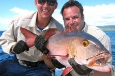 Brett Lee and friend shows red bass fish