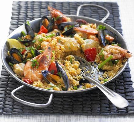 Great paella recipe. Easy and delicious. Make easier by replacing prawns and mussels with frozen seafood mix. YUMMMY