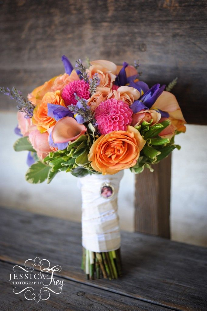 Color of the calla lilies is stunning. Pink dahlias and orange roses