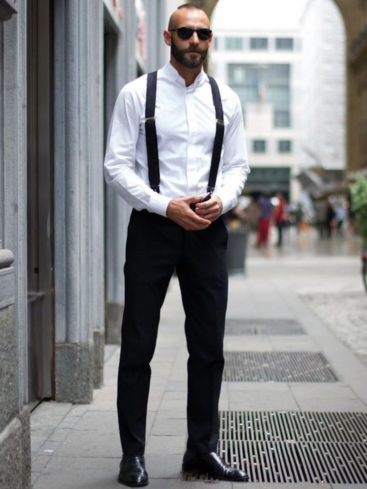 Shop this look on Lookastic:  https://lookastic.com/men/looks/dress-shirt-dress-pants-oxford-shoes-sunglasses-suspenders/10621  — Black Sunglasses  — White Dress Shirt  — Black Suspenders  — Black Dress Pants  — Black Leather Oxford Shoes