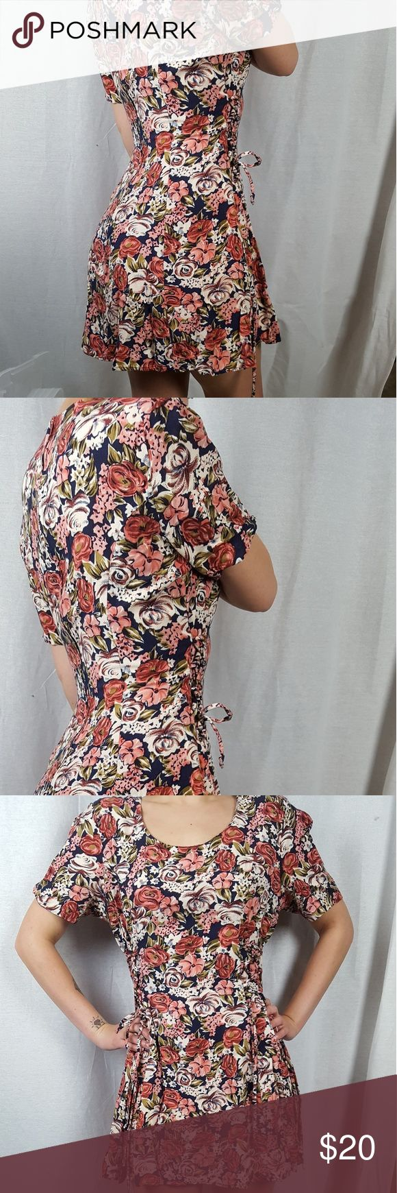 Adorable Orange and Blue Floral Print Dress One of my favorite dresses, it's super cute and super comfy. I can't remember exactly what store I bought it from, and it doesn't have any tags, but it's from an Urban Outfitter or a Pacsun.  It's got a zip in the back and laces on the sides and has a kind of skater dress shape to it. It's in near perfect condition, no tears, wear, or stains.  The price is negotiable. Feel free to make an offer or ask me any questions you may have :) Dresses Mini