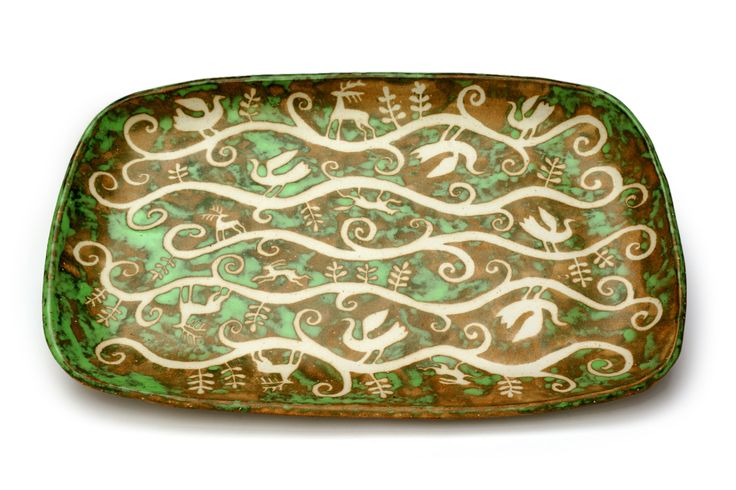 Green dish with resist decoration.