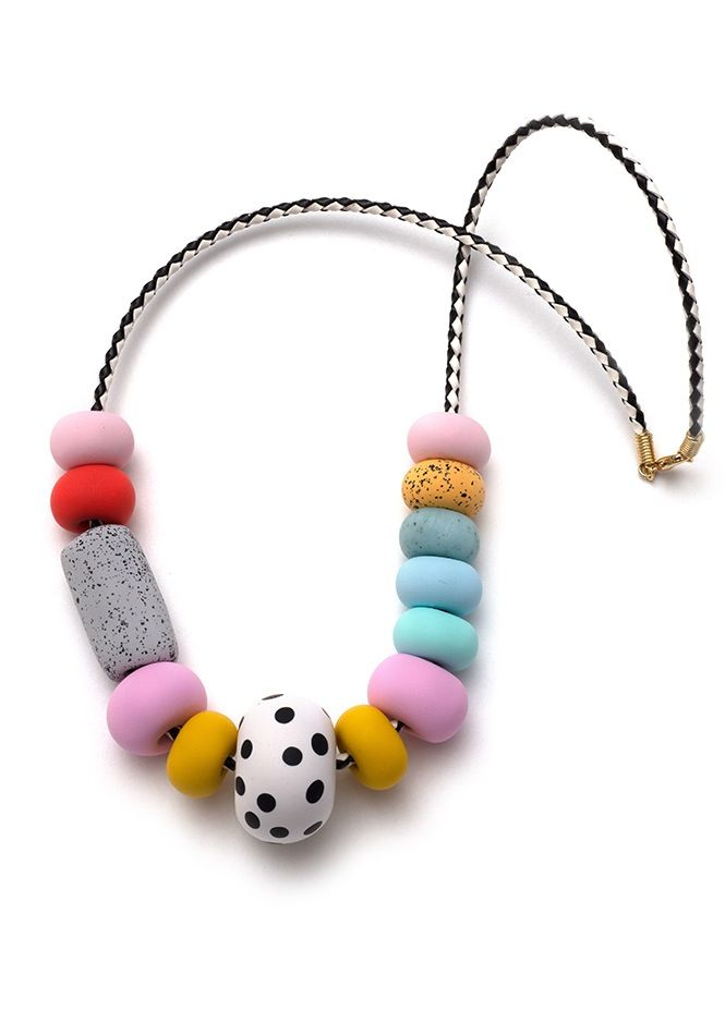 This necklace is part of the China Blue range and features spotty and speckled hand-formed polymer clay beads in tones of fondant pink, cadmium yel...