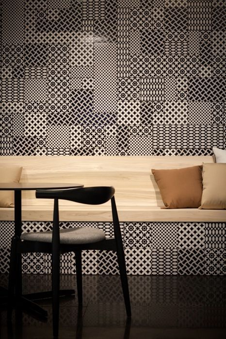 Different patterns in the same colour creating a tile effect is perfect for a feature wall. Add contrasting light wood and plain accessories to make an impact. Perfect for dining rooms and kitchens.