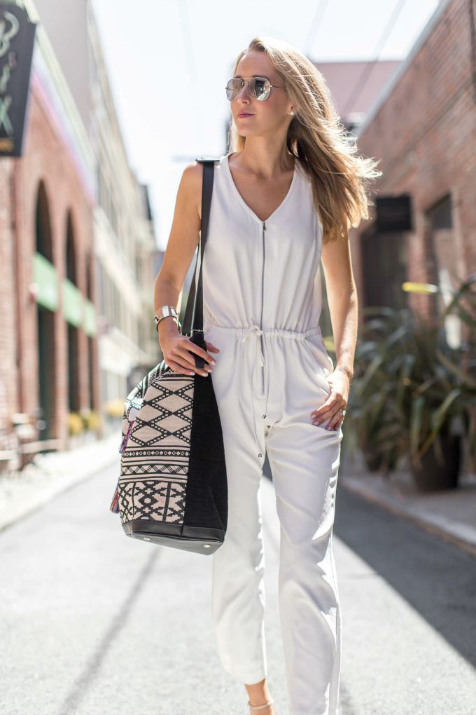 This all white jumpsuit is a casual Friday staple and paired with a statement tote makes the perfect weekend getaway outfit.