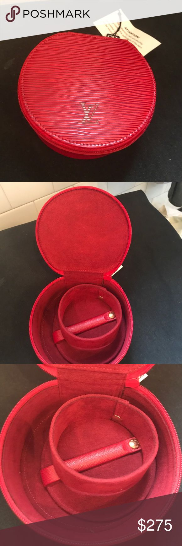 Louis Vuitton Red Epi Ecrin Bijoux Jewelry Case Authentic Louis Vuitton watch and jewelry case. Red with textured outer. Zip around closure with red enamel LV zipper pull, detachable watch holder and snapped pillow for necklaces and rings. Never used, still has authenticity card. Make me an offer! Louis Vuitton Bags Travel Bags