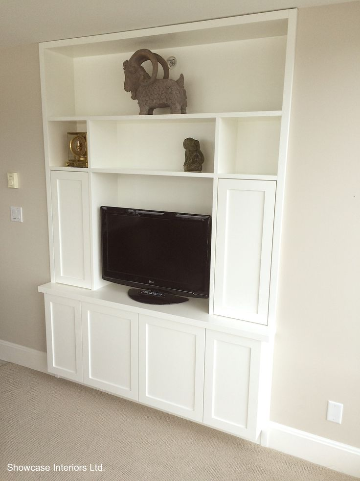 A custom built-in. in Benjamin Moore Cloud White and Benjamin Moore Muslin on the Walls.