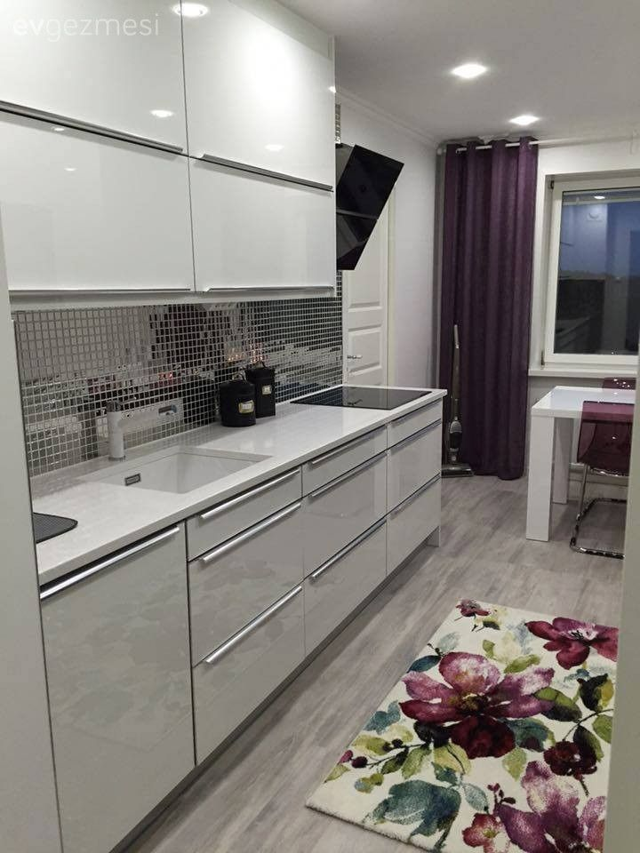 High gloss cabinets bring this small kitchen to life: http://na.rehau.com/brilliant