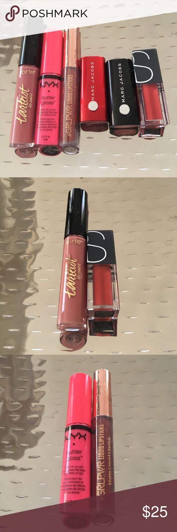 High end lip color set Tarte tarteist lip paint in tbt. (Swatched once). Nyx butter gloss in cupcake (swatched once). The beauty crop matte liquid lipstick in imma browse. (New, unused). Marc Jacobs lip creme in kiss kiss bang bang (new, unused). Marc Jacobs lip creme in so rouge (swatched once). NARS velvet lip glide in Le Palace. (New, unused- comes with box). **small cosmetic case included as FREE gift!!** tarte Makeup Lipstick