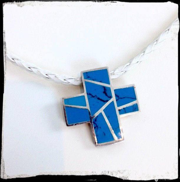 Now trending: Handmade Necklace - Turquoise Crystal Cross Pendant - 925 Silver on White Platted Cord https://www.etsy.com/listing/291128301/handmade-necklace-turquoise-crystal?utm_campaign=crowdfire&utm_content=crowdfire&utm_medium=social&utm_source=pinterest