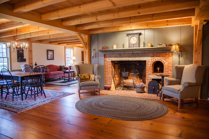 Love this open concept colonial home.  Love the fireplace, exposed beams, and wide plank floors!