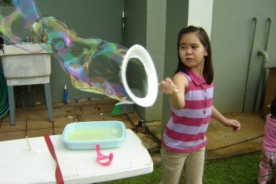 Paper plate bubble wand and bubble solution recipe made of baby shampoo