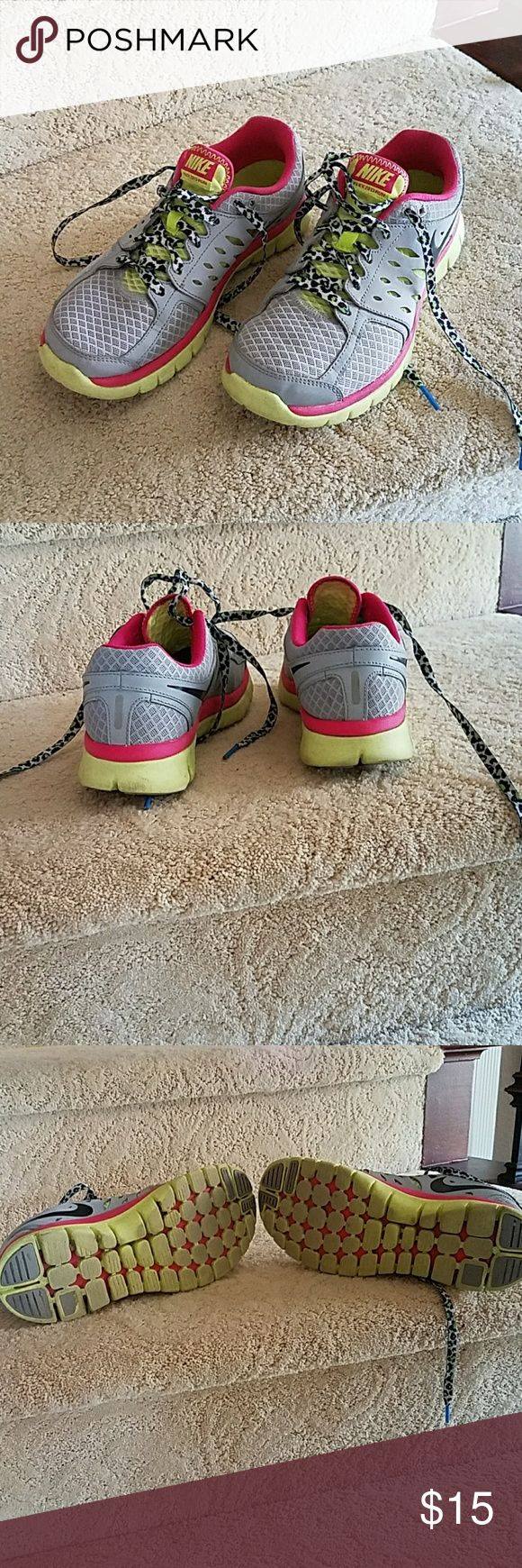 Nike workout shoes Grey, neon green and pink flex 2013 run shoes.  Well loved. nik Nike Shoes Sneakers
