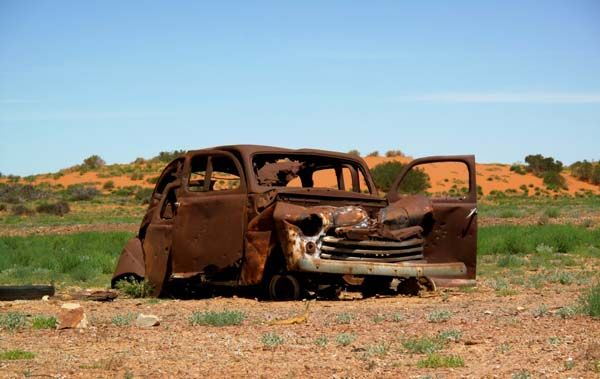 Extremely old rusted car in the harsh central Australian desert