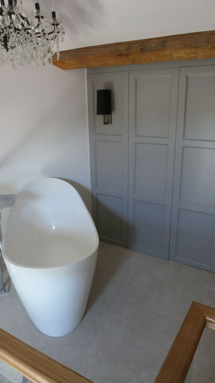 Concealed Bath Storage Behind Decorative Paneling