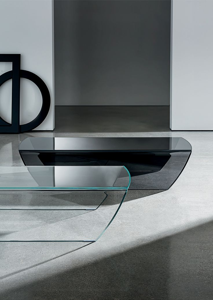 Find out the lightness of #glass through Taky coffee #table. The beauty of curved glass in an emotional shape. #interior #furniture #design #sovetitalia