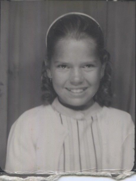 Vintage photo booth portrait. POISED YOUNG GIRL.