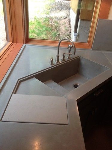 Large Concrete Corner Kitchen Sink With Sliding Cutting Board.