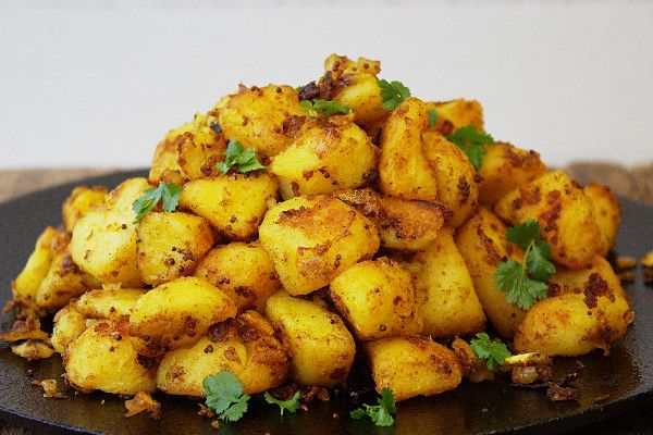 Easy Bombay Potatoes - the best ever Indian Spiced Roasties. The perfect partner for any curry recipe or to spice up your Sunday Roast!