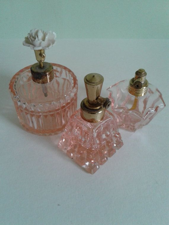 Vintage I Rice hand cut perfume bottles from japan. These vintage beauties are in great vintage condition! They were imported from japan probably in the 1940s.The large bottle has a pump atomizer that works and some discoloration on the gold plating. The smaller bottles are missing the original sqeeze atomizer and the gold plating is intact.All three are free of chips or cracks.Take a trip down memory lane and open each one and get a whiff of yesterday! These would make a great addition to…