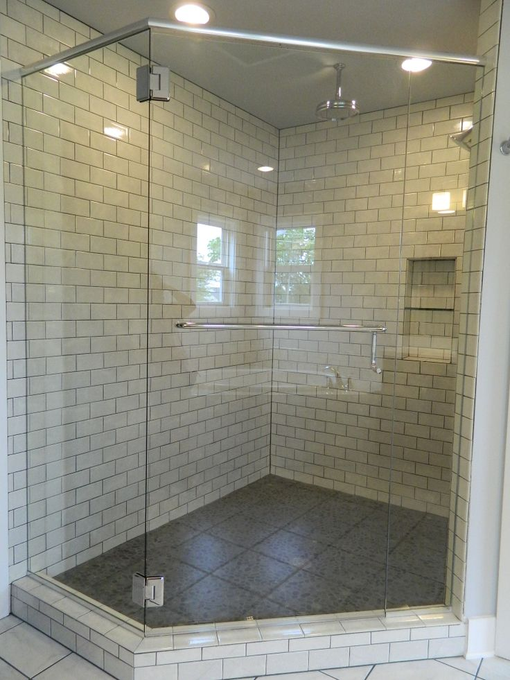 Pebbled Shower Floors With Subway Wall Tile Frameless