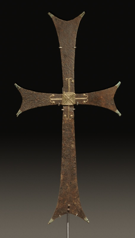 BYZANTINE LARGE IRON PROCESSIONAL CROSS. With numerous gilt bronze appliqués. Break below the crossing. 10th-12th Century AD
