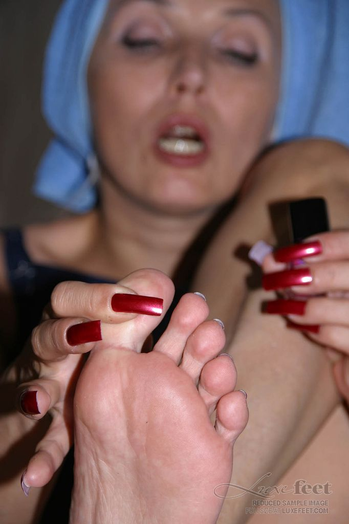 Beautiful sexy MILF in pedicure action (8)