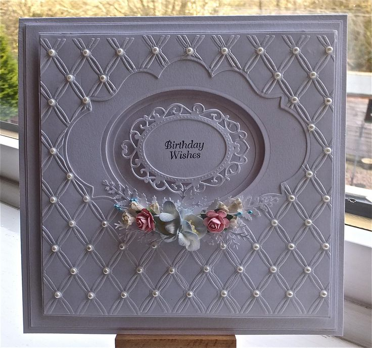 haandmade card by Debbie Stevens ... monochromatic lavender ... lu with little pearls on the crosses of the embossed texture ... depth with only one cardstock .... delightful!!