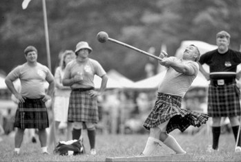 The hammer throw at the Highland Games on Grandfather Mountain. Photograph by Hugh Morton.