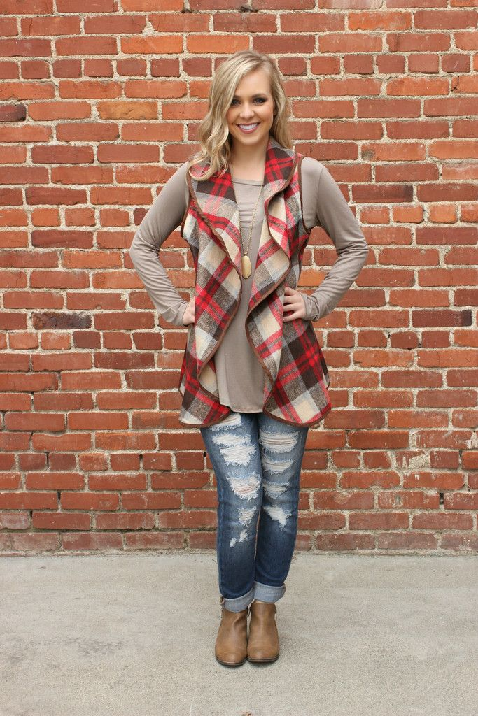 One of the most popular styles of the season, this full fleece plaid printed vest needed to in your closet yesterday! Chocolate brown, ivory, and red make complement a fun plaid pattern perfect for th