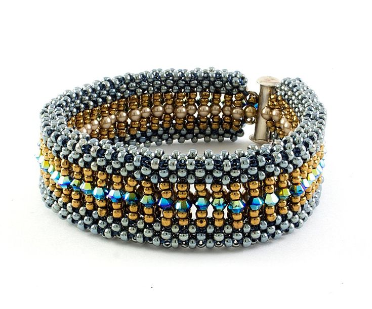 Different looks for different days! This Reversible Cubic Right Angle weave Bracelet has pearls on one side, and crystals on the other. Makes up to a 7.5 in bracelet. Skill Level: Intermediate Techniq
