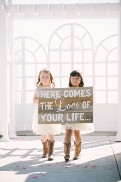 An adorable sign with cuties in cowboy boots: http://www.stylemepretty.com/california-weddings/2015/02/25/country-romance-at-delta-diamond/ | Photography: This Love of Yours - http://thisloveofyours.com/