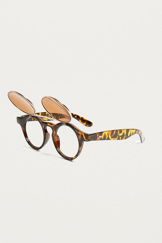 Sonnenbrille im Retrostyle mit runden, getönten Gläsern, die